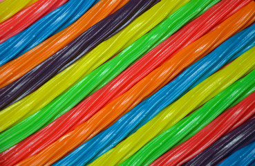 Rainbow colored licorice candy background