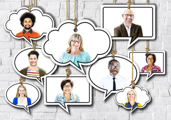 Group of People Smiling in Speech Bubble on Bricks Wall