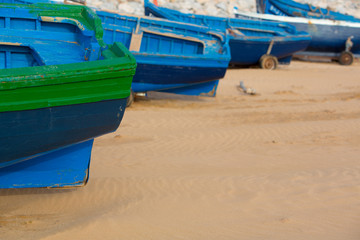 Blue fishing boats on the beach of Sidi Kaouki