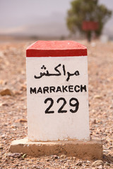 Road sign on the road to Marrakesh in Morocco