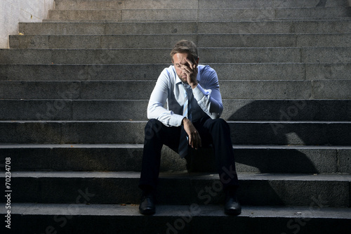 businessman crying depressed sitting on concrete stairs - 70234708
