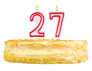 birthday cake with candles number twenty seven isolated on white
