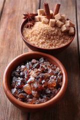 Brown sugar cubes, reed and crystal sugar in bowls