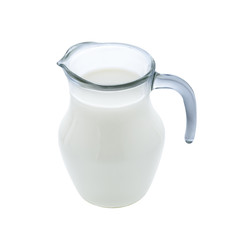 Glass jug of milk isolated on white