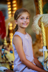 Merry-go-round - girl playing on carousel