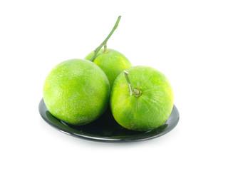 green orange fruit on white background