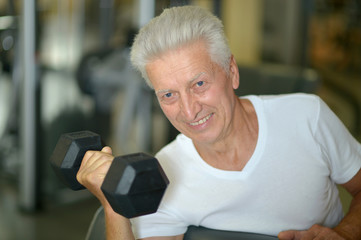Elderly man in a gym