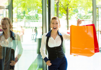 Shopping woman in New York City happy smiling holding bags