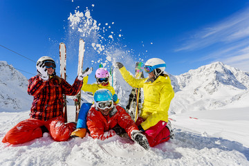 Ski, winter fun - skiers enjoying ski vacation