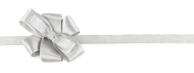 grey and silver ribbon and bow isolated on white