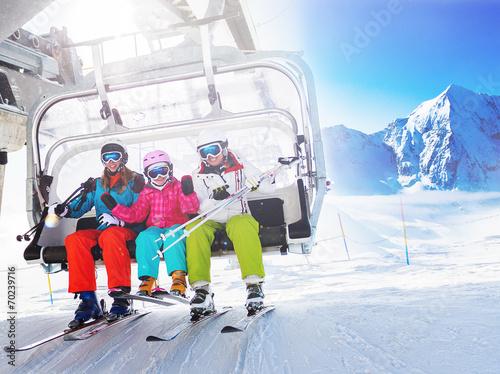 Ski, skiing - skiers on ski lift - 70239716