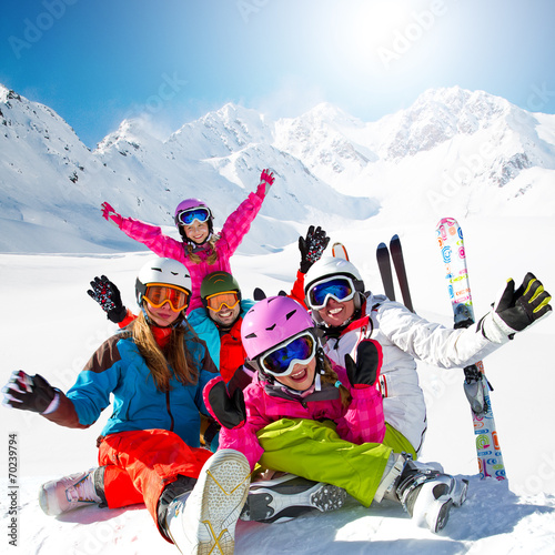 Skiing. Skiers enjoying winter vacation - 70239794