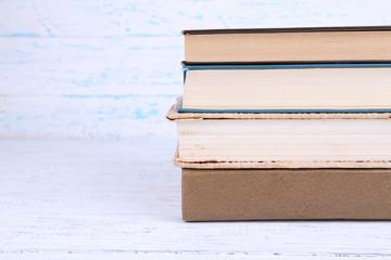 Books on light wooden background
