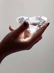 Female Hand Holding Oversized Diamond
