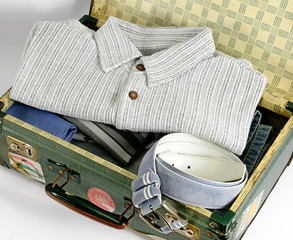 Open Suitcase Packed with Clothing