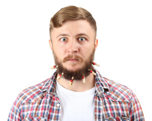 Portrait of handsome man with beard of clothespins isolated