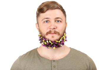 Portrait of handsome man with beard of flowers isolated on