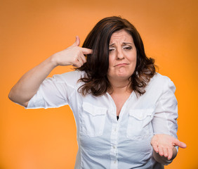 angry woman gesturing with finger asking are you crazy?