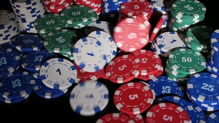 many poker chips falling on a black background. 2 pack. Slow