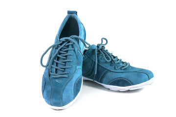 blue suede sports shoes on white background