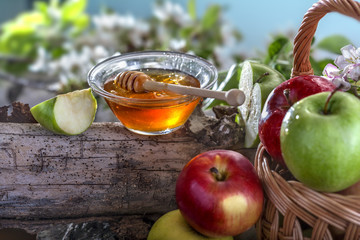 Domestic apples and honey on the natural rustic background