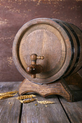 Barrel and ears on wooden table on wooden wall background