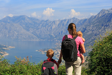 mother with kids looking at mountains on vacation