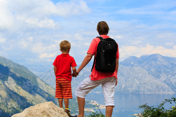 father and son looking at mountains on vacation