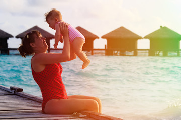 mother and little daughter playing on vacation
