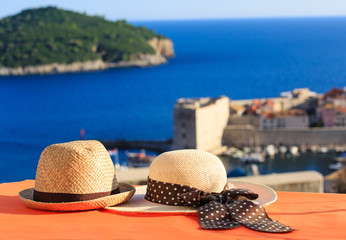 two hats on vacation in Europe