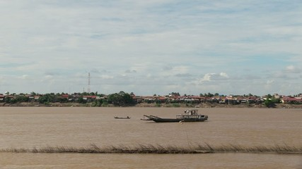 Old wood boat crossing the mekong river (2)