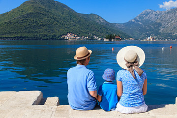 family with kid looking at scenic view