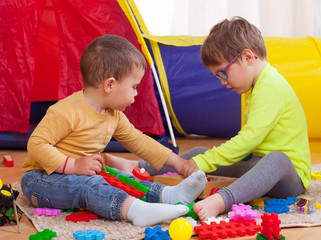 children playing   with colored toys.