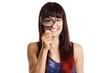 canvas print picture - junge Frau vergrößert ihr Auge mit einer Lupe