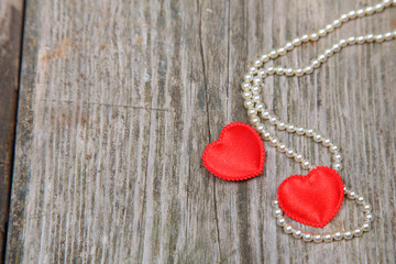 Two red hearts and beads
