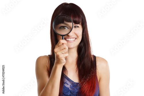 canvas print picture junge Frau vergrößert ihr Auge mit einer Lupe