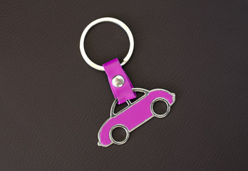 Key chain pink car on leather pad