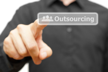 Businessman touching Outsourcing word