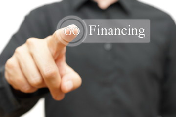 businessman pressing financing button. Credit or investment conc