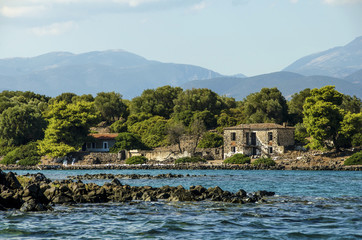 Old abandoned stone houses on a greek small island