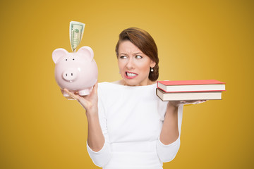 Cost of college education woman holds piggy bank books