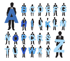 Silhouettes of Business People Holding Alphabet Texts