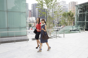 Two young women walk the business district