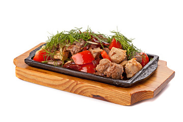 A mixture of various roasted meat with vegetables and herbs serv