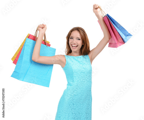 canvas print picture Beautiful young woman with shopping bags isolated on white