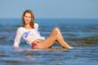 The beautiful blonde in the sea