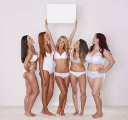 Girls in underwear peeking on whiteboard