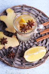Cup of ginger drink with lemon