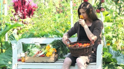 A woman with vegetables on a bench