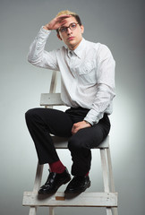 Businessman looks into the distance in career ladder concept